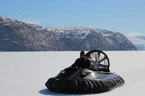 Nolwenn is driving a hovercraft through the frozen fjord during the winter to go maintenancing the scientific equipement