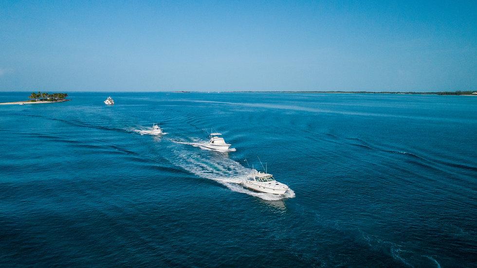 Boats leaving Gilligan's Island, Bahamas.