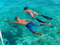 Couple snorkeling in the Bahamas.