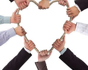 Hands holding rope forming a heart with
