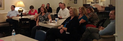 Who says networking meetings at a funeral home aren't fun? Look at all these smiling faces!