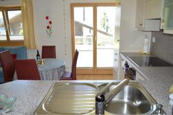 Küche mit Zugang zum Aussenbereich
