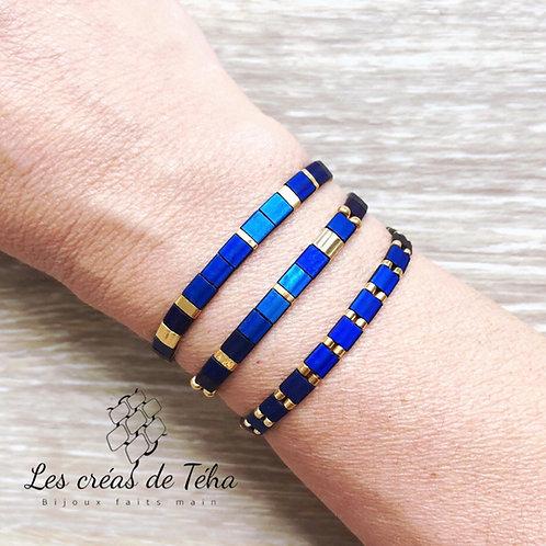 Bracelet Huira bleu et doré en perles de verre et cordon
