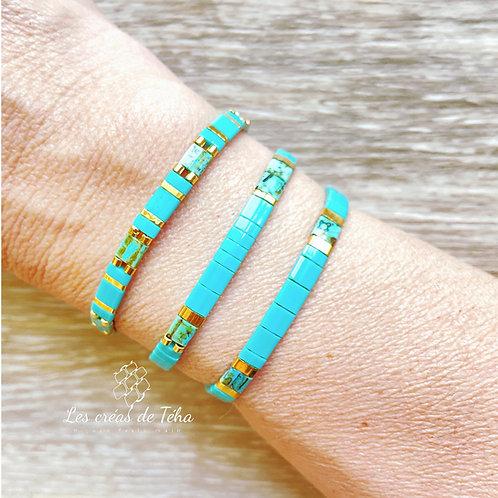 Bracelet Huira turquoise et doré en perles de verre et cordon