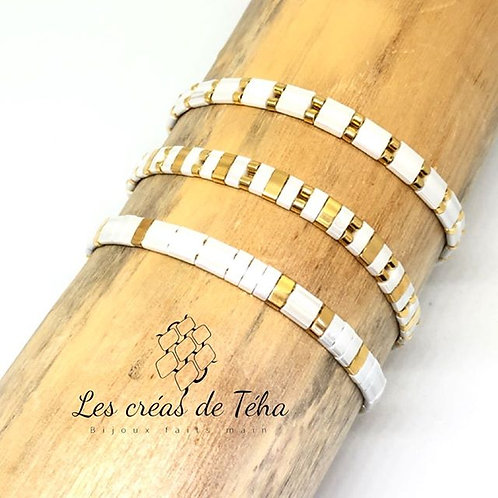 Bracelet fin blanc doré