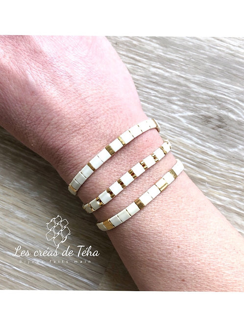 Bracelet Huira ivoire mat et doré en perles de verre et cordon