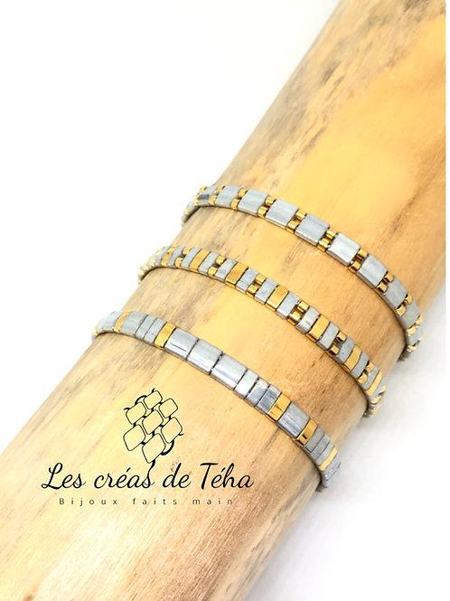 Bracelet fin gris et doré
