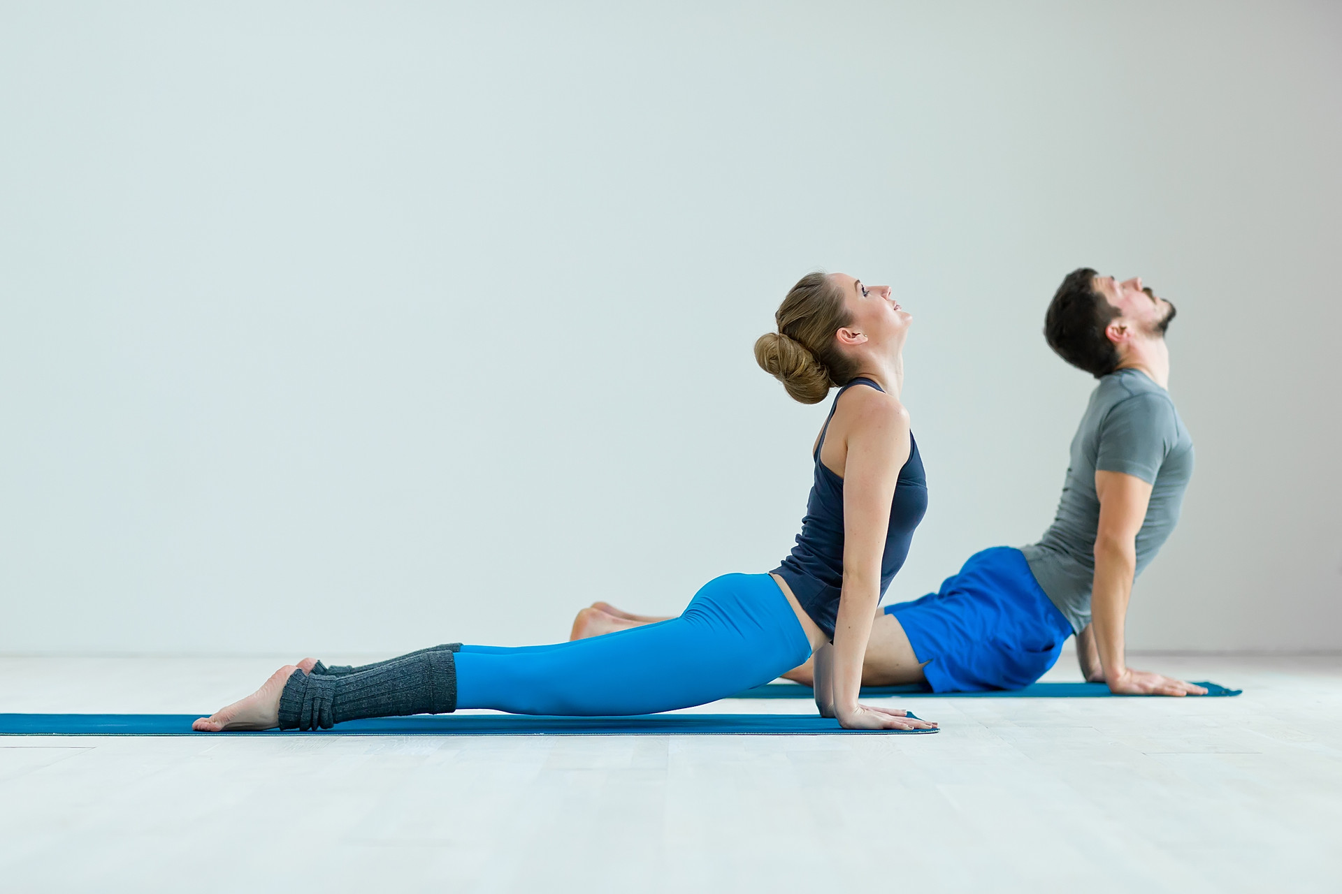 Young healthy couple in yoga position .j