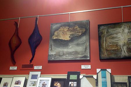 C15 art show hung above the art supply shelves