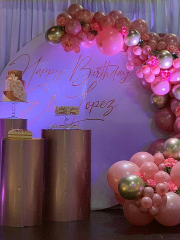 pink and white crescent balloon arrangement in event venue in Kendall Miami