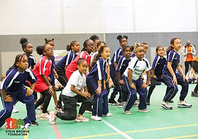 young dancers learn their routine.jpg