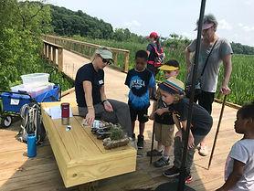 Children learning about wetlands at the Neabsco Creek Boardwalk, Woodbridge, VA.