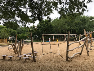 Eugene Simpson Playground and Passive Park. View toward the swings and ropes course.
