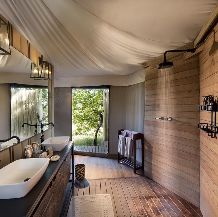 andBeyond-Nxabega-Okavango-Tented-Camp-Ensuite-Bathroom1