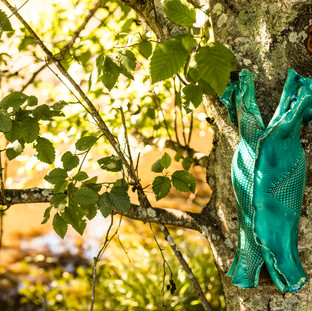 Our beautiful pottery mermaid beside the lake.