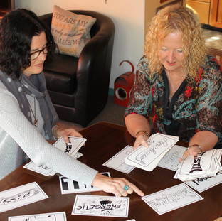 Katherine and Adele using the emotion cards in retreat preparation.