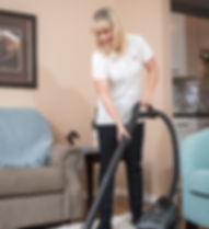 Heavenly Homes vacuuming a carpet in a Guelph home