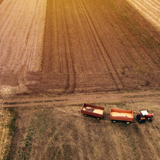 Aerial shot of tractor and fields