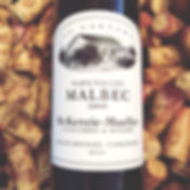 A photo of the lael on a bottle of Mckenzie-Mueller 2008 Malbec on a background of wine stained corks