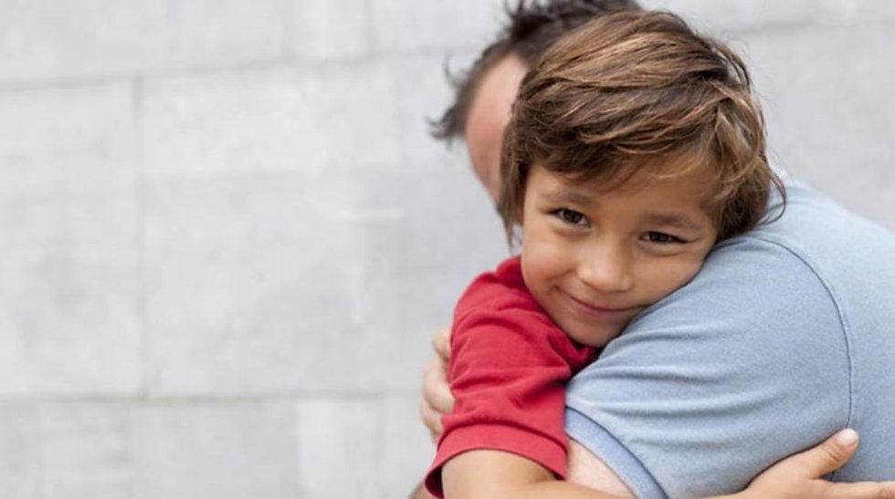 Son hugging father.jpg