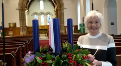 Rosemary lighting Advent wreath