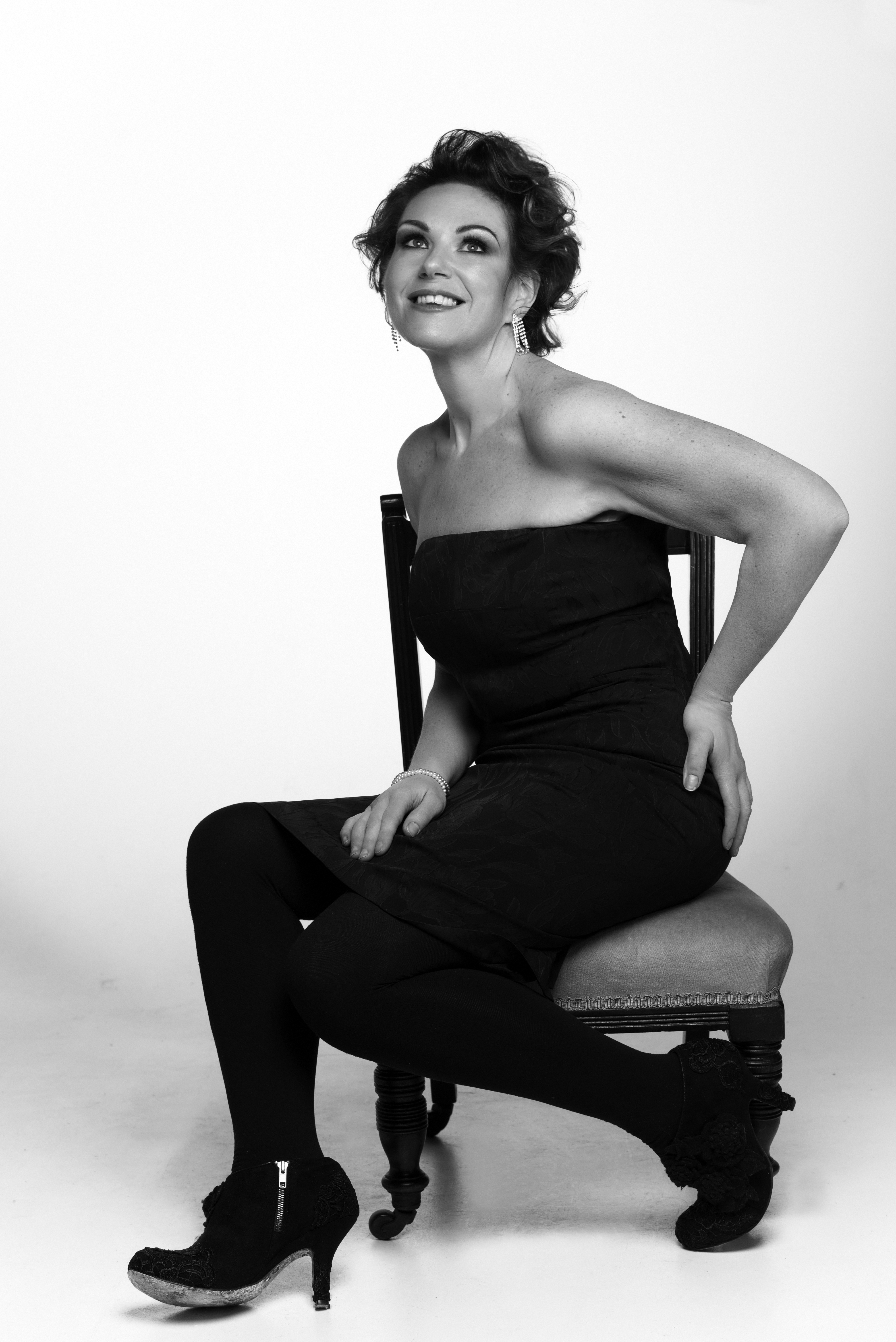 glamorous woman sitting on a chair