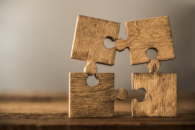 4 Four brown pieces of puzzle stand on w