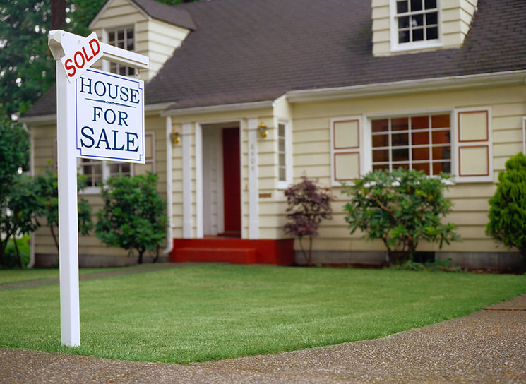 House-for-sale-sign-on-lawn-in-front-of house