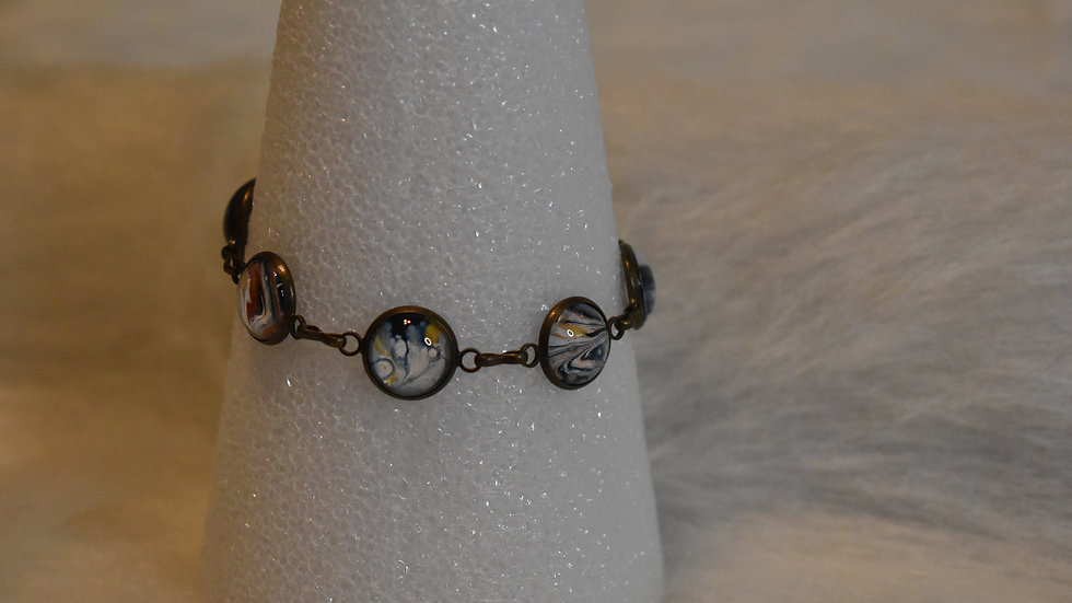 Multi stone bracelet in antique gold