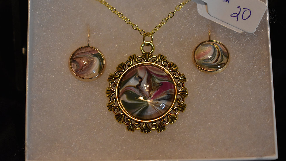 Deep olive, rich pink, gold  and vandyke brown in gold setting