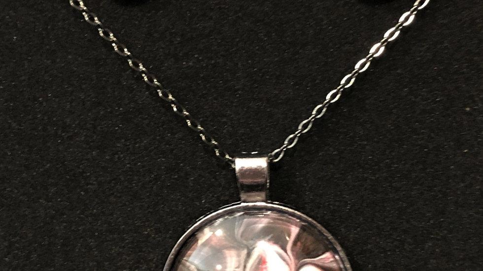 Mauve, gray, black and pearl in gunmetal setting