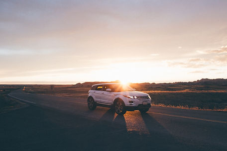 Car at Sunset, Badlands National Park, South Dakota, USA