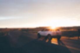 Car at Sunset, Badlands National Park, South Dakota, USA