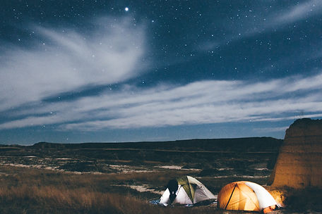 Camp at night, Badlands National Park, South Dakota, USA