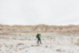 Person hiking, Badlands National Park, South Dakota, USA