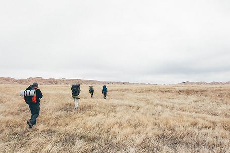 People hiking, Badlands National Park, South Dakota, USA