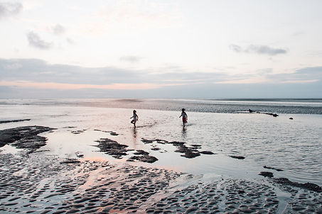 Children running on beach, Olmedo, Esmeraldas, Ecuador