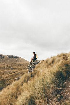 Hiker contemplates th view, Cajas National Park, Ecuador