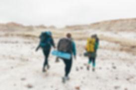 Three people hiking, Badlands National Park, South Dakota, USA