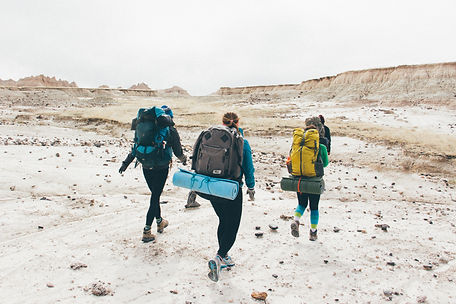 Three people hiking, Badlands National Park, South Dakota, USA