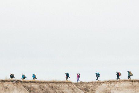 People hiking on a ridge, Badlands National Park, South Dakota, USA