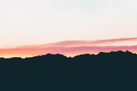 Pink clouds at sunset, Badlands National Park, South Dakota, USA