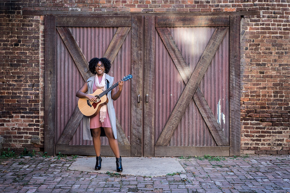 Maya Elizabeth with Taylor acoustic guitar