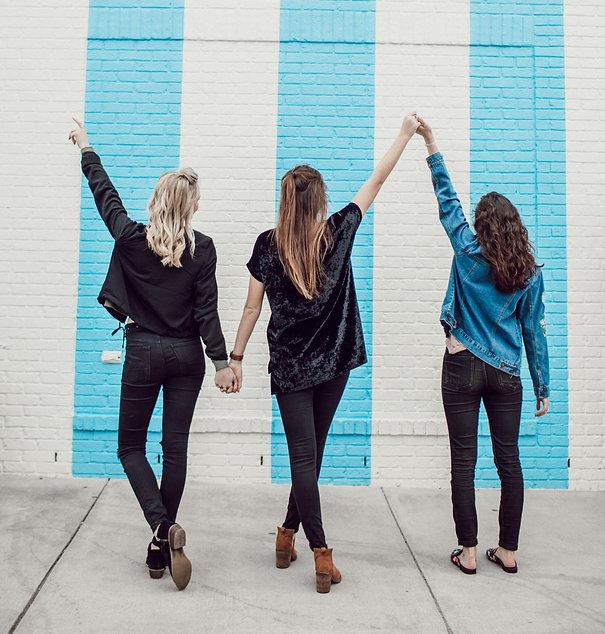 three woman holding hands white walking_edited.jpg