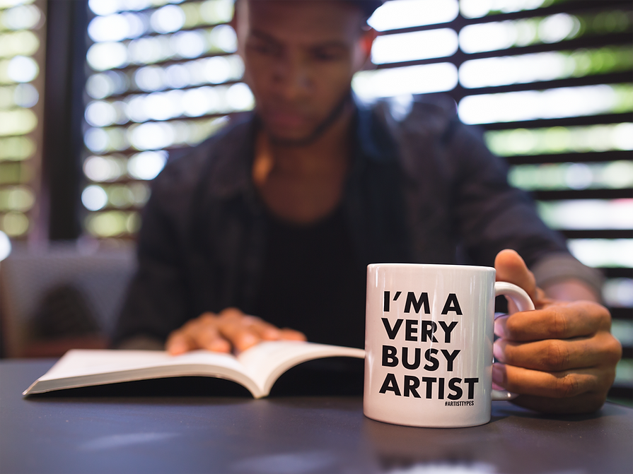 man-reading-a-book-and-holding-a-coffee-