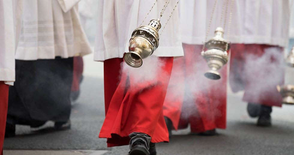 altar boys swirl vessels with incense on a procession on corpus christi in cologne_edited_