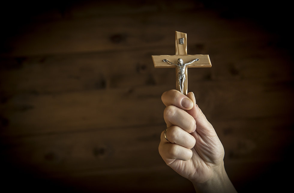 Woman's hands holding Catholic crucifix_edited.jpg