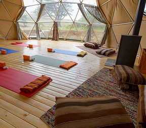 Communal area with yoga mats and meditaion cushions