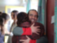Two people give warm embrace