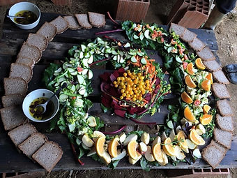Home made bread, fresh fruit and vegetables arranged in a spiral